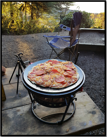 Making Pizza on a Dutch Oven Lid - Homestead Dreamer